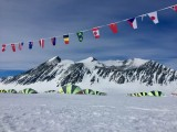Flags above Union Glacier Camp's accommodation precinct